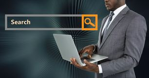 Businessman using laptop by search bar. Digital composite of Businessman using laptop by search bar Stock Photography