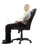 Businessman using laptop while seated stock images