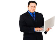 Businessman using laptop and smiling Stock Image