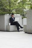 Businessman Using Laptop On Stone Bench Stock Image