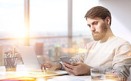 Businessman using laptop sunlight Royalty Free Stock Image