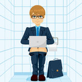 Businessman Using Laptop On Toilet Royalty Free Stock Images