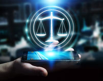 Businessman using law protection right 3D rendering. Businessman on blurred background using law protection right 3D rendering Royalty Free Stock Photos