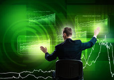 Businessman using media interface Stock Images