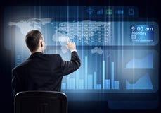 Businessman using media interface Stock Photos