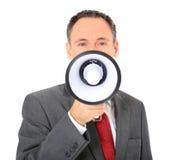 Businessman using megaphone Royalty Free Stock Photography
