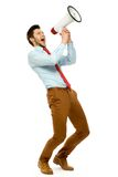 Businessman using megaphone. Young man over white background Stock Photo