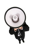 Businessman Using a Megaphone. Businessman Shouting Through Megaphone, standing over white background Royalty Free Stock Image