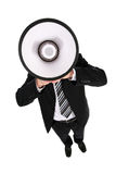 Businessman Using a Megaphone. Businessman Shouting Through Megaphone, standing over white background Stock Images