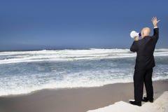 Businessman Using Megaphone On Beach Royalty Free Stock Photos