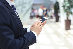 Businessman using mobile Stock Photo