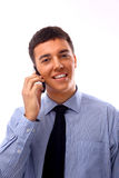 Businessman using mobile phone. Young businessman using mobile phone stock photography