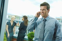 Businessman using mobile phone Stock Images