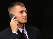 Businessman using a mobile phone. On black background Stock Photo