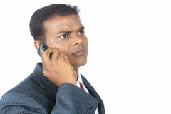 Businessman using a mobile phone. Indian businessman using a mobile phone Stock Images