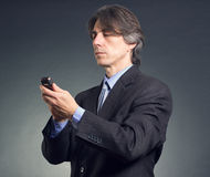 Businessman using a mobile phone Royalty Free Stock Photos