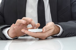 Businessman using  a mobile phone Stock Images
