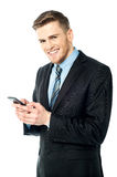 Businessman using mobile phone Royalty Free Stock Image