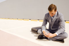 A businessman using a mobile phone Royalty Free Stock Photography