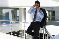 A businessman using a mobile phone Royalty Free Stock Image