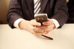 Businessman using mobile phone Royalty Free Stock Photos