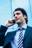 A businessman using mobile phone b Royalty Free Stock Image