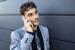 Businessman using a mobile phone in business environment Royalty Free Stock Photo