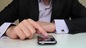 Businessman using mobile phone. For text messaging stock footage
