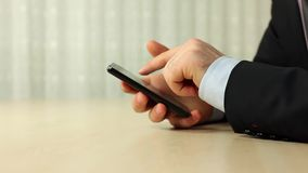 Businessman using mobile phone. For text messaging stock video footage