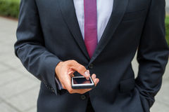 Businessman using mobile phone. Close up. Stock Image