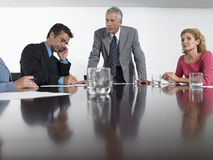 Businessman Using Mobile Phone In Conference Room Royalty Free Stock Photo