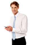Businessman using mobile phone Stock Photography