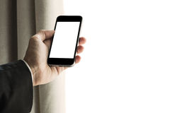 Businessman using mobile phone with curtain opened. and copy space Stock Photography