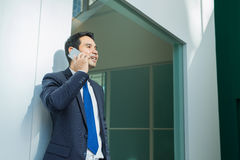 Businessman using mobile phone indise office building Royalty Free Stock Photo