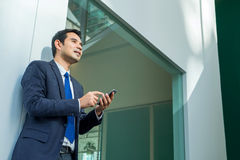 Businessman using mobile phone indise office building Stock Photo