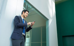 Businessman using mobile phone indise office building,after work Stock Image