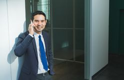 Businessman using mobile phone indise office building,after work Stock Photo