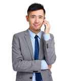 Businessman using mobile phone Royalty Free Stock Images