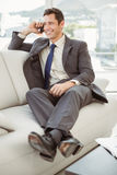 Businessman using mobile phone in living room Stock Photos