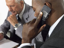 Businessman Using Mobile Phone In Meeting Royalty Free Stock Image