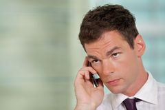Businessman using mobile phone at office Royalty Free Stock Photography