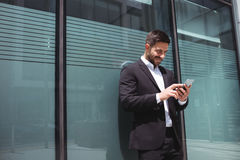 Businessman using mobile phone Royalty Free Stock Photo