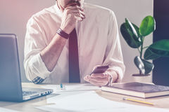 Businessman using mobile phone at office desk Royalty Free Stock Photography