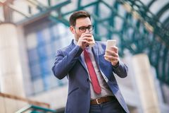 Businessman using mobile phone royalty free stock photo