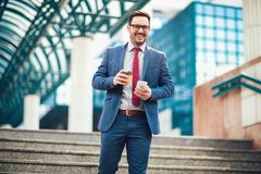Businessman using mobile phone outside of office buildings Royalty Free Stock Photography