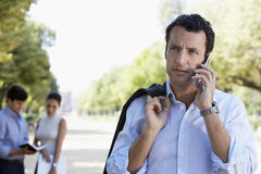 Businessman Using Mobile Phone On Road Royalty Free Stock Photography
