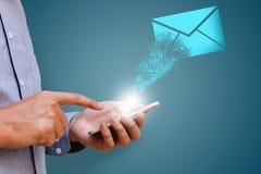 Businessman using mobile phone sending e-mail for customer Royalty Free Stock Image