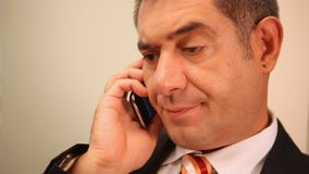 Businessman using mobile phone, smiling stock footage