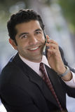 Businessman using mobile phone, smiling, close-up, portrait Stock Photos