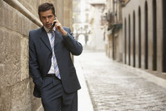 Businessman Using Mobile Phone In Street Stock Image